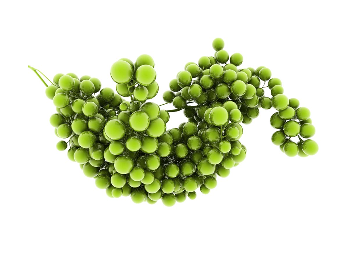 Cluster of green grapes isolated on white background