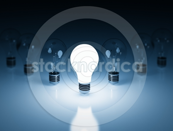 Light bulb lamps on a blue colour background