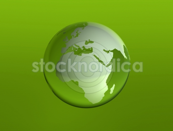 World glass globe on green background